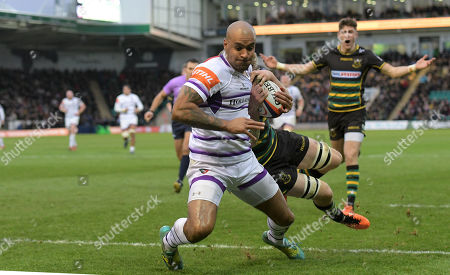 Leicester's Tom Varndell about to touch down for a try is prevented from doing so by Northampton's Jamie Gibson