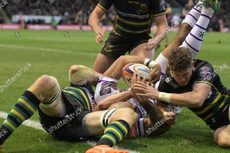 Leicester's Tom Varndell (Middle) about to touch down for a try is prevented from doing so by Northampton's Jamie Gibson and James Grayson (Right)