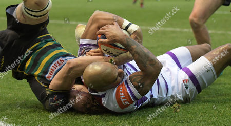 Leicester's Tom Varndell (Right) about to touch down for a try is prevented from doing so by Northampton's Jamie Gibson