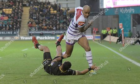 Stock Image of Leicester's Tom Varndell (Right) charges through a tackle by Northampton's Ken Pisi