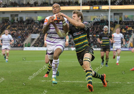 Stock Photo of Leicester's Tom Varndell (Left) chases and wins kick ahead which Jamie Gibson (Right) eventually prevented a touch down