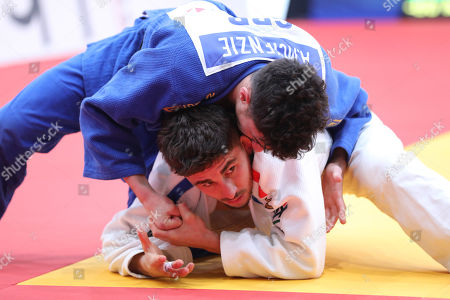 Cedric Revol of France (white) in action against British Ashley McKenzie (white) at the men's  under 60 kg weight competition at  the Tel Aviv Grand Prix Judo tournament in Tel Aviv, Israel, 24 January 2019.
