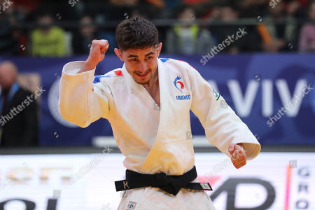Stock Photo of Cedric Revol of France celebrates wining against British Ashley McKenzie at the men's  under 60 kg weight competition at  the Tel Aviv Grand Prix Judo tournament in Tel Aviv, Israel, 24 January 2019.