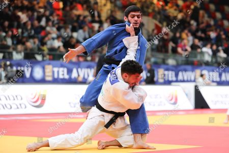 British judoka Ashley McKenzie (white) in action against Russian judoka Sakhavat Gadzhiev (blue) during their fight in the men?s  -60kg category at the Tel Aviv Grand Prix judo tournament, in Tel Aviv , Israel, 24 January 2019.
