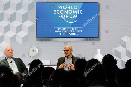 Microsoft's CEO Satya Nadella, right, attends a session with the founder of the World Economic Forum Klaus Schwab, left, during the at annual meeting of the of the organisation in Davos, Switzerland