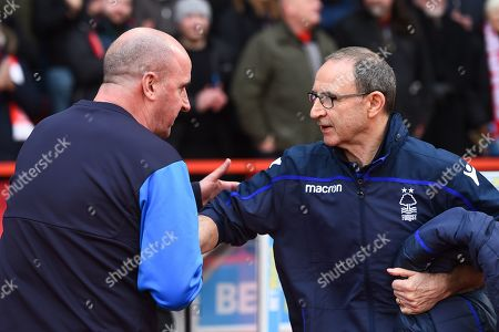 Martin O?Neill Manager of Nottingham Forest shakes hands with Paul Cook Manager of Wigan