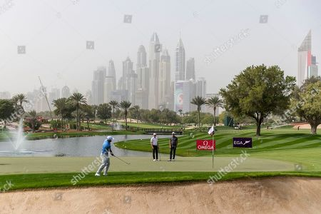 Shane Lowry. Kurt Kitayama of the U.S. chips onto the green on the 4th hole, watched by Eddie Pepperell of England, center, and Alexander Bjork of Sweden, during round one of the Dubai Desert Classic golf tournament, in Dubai, United Arab Emirates