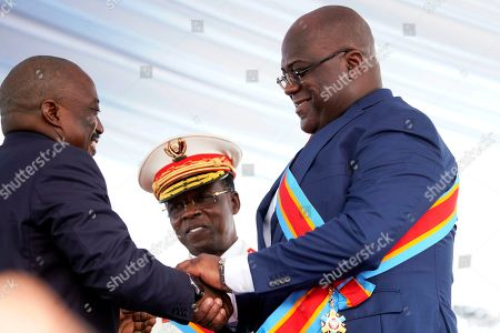 Congolese President Felix Tshisekedi, right, shakes hand with president Joseph Kabila after being sworn in in Kinshasa, Democratic Republic of the Congo,. Tshisekedi won an election that raised numerous concerns about voting irregularities amongst observers as the country chose a successor to longtime President Kabila