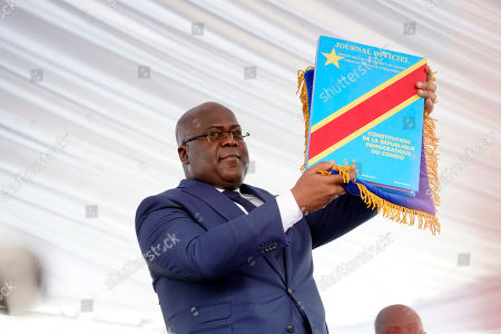 Congolese President Felix Tshisekedi holds the constitution after being sworn in in Kinshasa, Democratic Republic of the Congo,. Tshisekedi won an election that raised numerous concerns about voting irregularities amongst observers as the country chose a successor to longtime President Joseph Kabila
