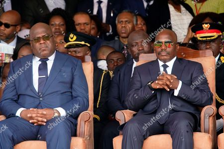 Congolese President Felix Tshisekedi, left, and outgoing president Joseph Kabila sit side by side during the inauguration ceremony in Kinshasa, Democratic Republic of the Congo,. Tshisekedi won an election that raised numerous concerns about voting irregularities amongst observers as the country chose a successor to longtime President Kabila