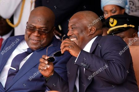 Congolese President Felix Tshisekedi, left, and outgoing president Joseph Kabila share a light moment side during the inauguration ceremony in Kinshasa, Democratic Republic of the Congo,. Tshisekedi won an election that raised numerous concerns about voting irregularities amongst observers as the country chose a successor to longtime President Kabila