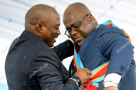 Congolese President Felix Tshisekedi receives the presidential sash from outgoing president Joseph Kabila after being sworn in in Kinshasa, Democratic Republic of the Congo,. Tshisekedi won an election that raised numerous concerns about voting irregularities amongst observers as the country chose a successor to longtime President Kabila