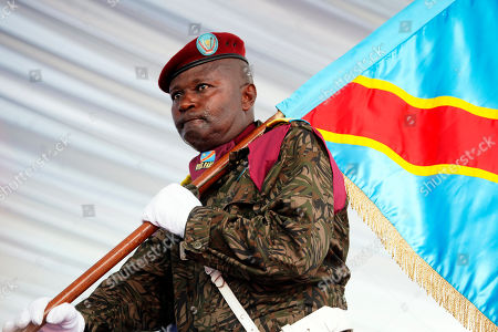 A Congolese soldier carried the presidential flag during President Felix Tshisekedi's inauguration in Kinshasa, Democratic Republic of the Congo,. Tshisekedi won an election that raised numerous concerns about voting irregularities amongst observers as the country chose a successor to longtime President Joseph Kabila