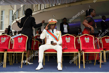 An officer salutes as he waits for other guests for Congolese President elect Felix Tshisekedi inauguration in Kinshasa, Democratic Republic of the Congo,. Tshisekedi won an election that raised numerous concerns about voting irregularities amongst observers as the country chose a successor to longtime President Joseph Kabila