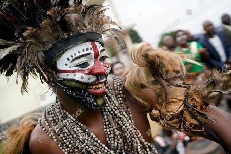A traditional dancer performs as supporters of Congolese President elect Felix Tshisekedi gather at the Palais de la Nation for his inauguration in Kinshasa, Democratic Republic of the Congo,. Tshisekedi won an election that raised numerous concerns about voting irregularities amongst observers as the country chose a successor to longtime President Joseph Kabila