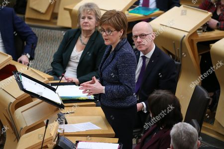Scottish Parliament First Minister's Questions - Roseanna Cunningham, Cabinet Secretary for Environment, Climate Change and Land Reform, Nicola Sturgeon, First Minister of Scotland and Leader of the Scottish National Party (SNP), and John Swinney, Deputy First Minister and Cabinet Secretary for Education and Skills