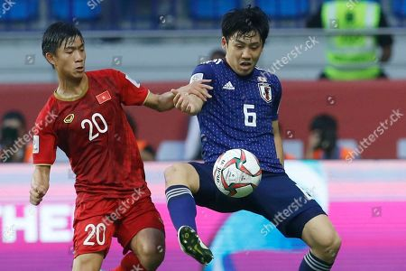 Vietnam's forward Phan Van Duc, left, fights for the ball with Japan's defender Wataru Endo during the AFC Asian Cup quarterfinal soccer match between Japan and Vietnam at Al Maktoum Stadium in Dubai, United Arab Emirates