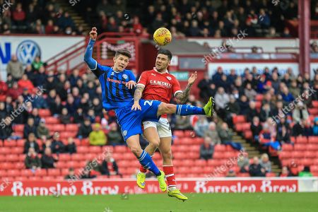 Alex Mowatt (27) of Barnsley and Roy Holden (23) of Rochdale dual for the ball
