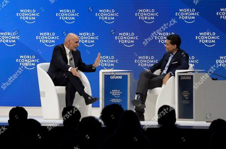 Stock Image of Afghanistan's President Ashraf Ghani talks with journalist Fareed Zakaria, right, during a session at the annual meeting of the World Economic Forum in Davos, Switzerland