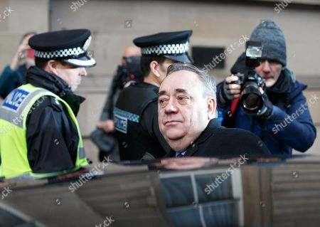 Former Scottish first minister Alex Salmond (C) leaves Edinburgh Sheriff Court with his legal team after he was arrested and charged by police in Edinburgh, Scotland, Britain, 24 January 2019. Media reports on 24 January 2019 state Salmond said he is 'innocent of any criminality'. Alex Salmond has been arrested by police. Police Scotland confirmed that a 64 year old man had been charged and said a report would be sent to prosecutors.