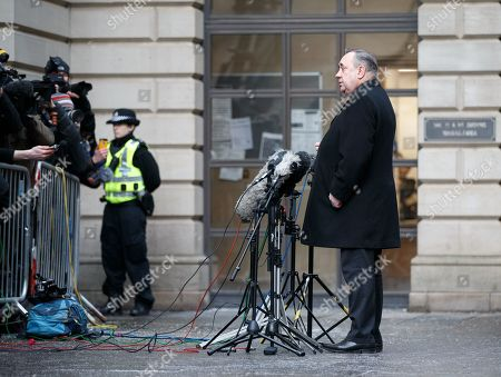 Former Scottish first minister Alex Salmond (C) speaks to the media as he leaves Edinburgh Sheriff Court with his legal team after he was arrested and charged by police in Edinburgh, Scotland, Britain, 24 January 2019. Media reports on 24 January 2019 state Salmond said he is 'innocent of any criminality'. Alex Salmond has been arrested by police. Police Scotland confirmed that a 64 year old man had been charged and said a report would be sent to prosecutors.