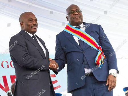 DR Congo's new President Felix Tshisekedi (R) and the outgoing President Joseph Kabila (L) shake hands during the inauguration ceremony at the Palais de Nation in Kinshasa, the Democratic Republic of the Congo, 24 January 2019. Tshisekedi, the son of the country's veteran opposition leader, was sworn-in as the country's new President after disputed elections.