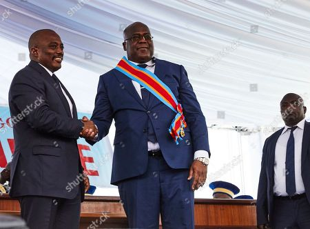 DR Congo's new President Felix Tshisekedi (C) and the outgoing President Joseph Kabila (L) shake hands during the inauguration ceremony at the Palais de Nation in Kinshasa, the Democratic Republic of the Congo, 24 January 2019. Tshisekedi, the son of the country's veteran opposition leader, was sworn-in as the country's new President after disputed elections.