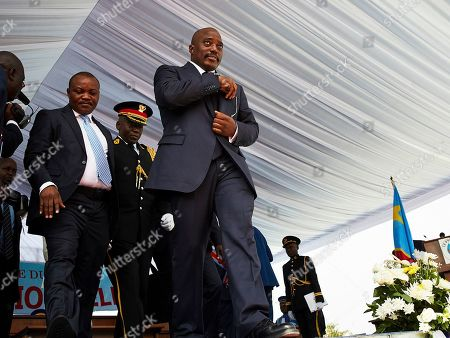 Stock Picture of DR Congo's outgoing President Joseph Kabila (C) walks off the stage as the new President Felix Tshisekedi (not pictured) remains on the stage during the inauguration ceremony at the Palais de Nation in Kinshasa, the Democratic Republic of the Congo, 24 January 2019. Tshisekedi, the son of the country's veteran opposition leader, was sworn-in as the country's new President after disputed elections.