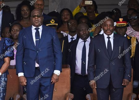 DR Congo's new President Felix Tshisekedi (L) and the outgoing President Joseph Kabila (R) stand together during the inauguration ceremony at the Palais de Nation in Kinshasa, the Democratic Republic of the Congo, 24 January 2019. Tshisekedi, the son of the country's veteran opposition leader, was sworn-in as the country's new President after disputed elections.