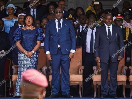 DR Congo's new President Felix Tshisekedi (C) and the outgoing President Joseph Kabila (R) stand together during the inauguration ceremony at the Palais de Nation in Kinshasa, the Democratic Republic of the Congo, 24 January 2019. Tshisekedi, the son of the country's veteran opposition leader, was sworn-in as the country's new President after disputed elections.