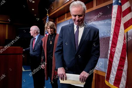 Ben Cardin, Lisa Murkowski, Chris Van Hollen. From left, Sen. Ben Cardin, D-Md., Sen. Lisa Murkowski, R-Alaska, and Sen. Chris Van Hollen, D-Md., leave a news conference after two Senate bills to ending the partial government shutdown fail on Capitol Hill in Washington