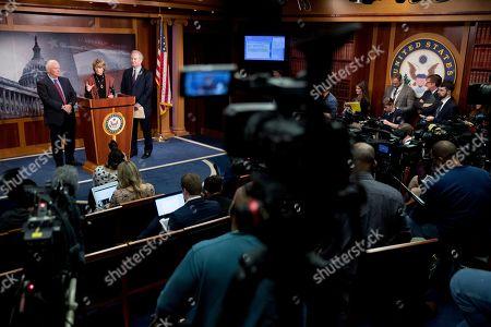 Ben Cardin, Lisa Murkowski, Chris Van Hollen. From left, Sen. Ben Cardin, D-Md., Sen. Lisa Murkowski, R-Alaska, and Sen. Chris Van Hollen, D-Md., hold a news conference after two Senate bills to ending the partial government shutdown failed on Capitol Hill in Washington