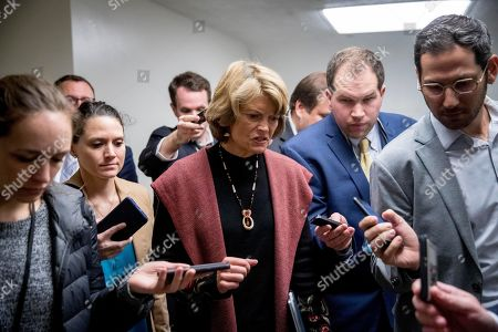Sen. Lisa Murkowski, R-Alaska, speaks to reporters as he arrives at the US Capitol building on Capitol Hill in Washington