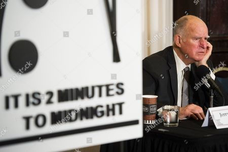 Former California Gov. Jerry Brown listens to a reporters question after unveiling the Doomsday Clock during The Bulletin of the Atomic Scientists news conference in Washington, . The Doomsday Clock is set at two minutes to Midnight