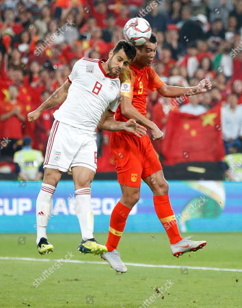 Xiao Zhi of China (R) in action against Morteza Pouraliganji of Islamic Republic of Iran during the 2019 AFC Asian Cup quarter final round match between China and Islamic Republic of Iran in Abu Dhabi, United Arab Emirates, 24 January 2019.