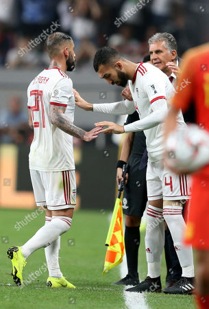 Seyed Ashkan Dejagah (L) of Islamic Republic of Iran leaves as he is substituted by his team mate Roozbeh Cheshmi (R) during the 2019 AFC Asian Cup quarter final round match between China and Islamic Republic of Iran in Abu Dhabi, United Arab Emirates, 24 January 2019.