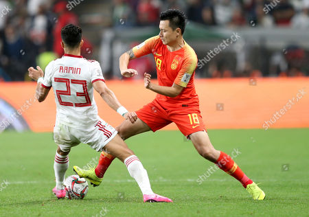 Gao Lin (R) of China in action against Ramin Rezaeian Maskandi of Islamic Republic of Iran during the 2019 AFC Asian Cup quarter final round match between China and Islamic Republic of Iran in Abu Dhabi, United Arab Emirates, 24 January 2019.