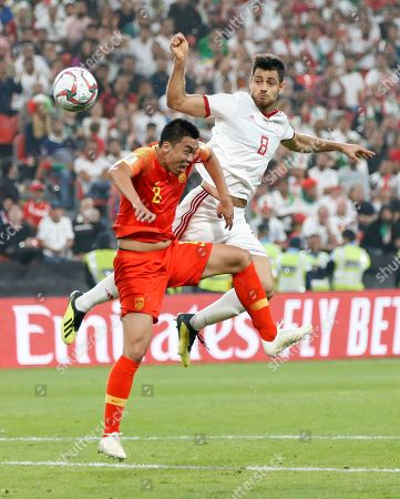 Morteza Pouraliganji (R) of Islamic Republic of Iran in action against Zhao Xuri of China during the 2019 AFC Asian Cup quarter final round match between China and Islamic Republic of Iran in Abu Dhabi, United Arab Emirates, 24 January 2019.