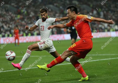 China's forward Gao Lin shoots by Iran's defender Ramin Rezaeian during the AFC Asian Cup quarterfinal soccer match between Iran and China at Mohammed Bin Zayed Stadium in Abu Dhabi, United Arab Emirates