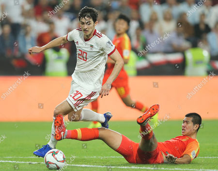 Iran's forward Sardar Azmoun passes China's defender Liu Yiming to score his team's second goal by China's goalkeeper Yan Junling during the AFC Asian Cup quarterfinal soccer match between Iran and China at Mohammed Bin Zayed Stadium in Abu Dhabi, United Arab Emirates