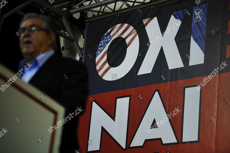 Dimitris Koutsoumpas, General Secretary of Greece's Communist Party delivers a speech during a rally against Prespa Agreement in Athens, . The poster reads in Greek: 'NO' top, decorated with the flags of USA and NATO, and 'YES', bottom. Greek lawmakers are debating a historic agreement aimed at normalising relations with Macedonia in a stormy parliamentary session scheduled to culminate in a Friday vote