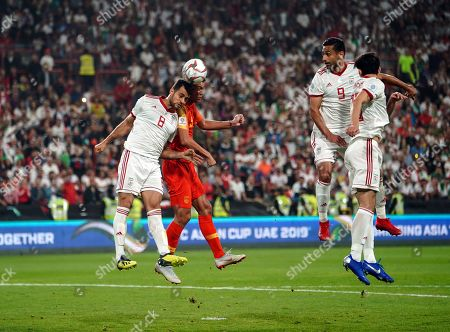 Zhang Linpeng of China and Morteza Pouraliganji of Iran challenging for the ball during China v Iran at the Mohammed Bin Zayed Stadium in Abu Dhabi, United Arab Emirates, AFC Asian Cup, Asian Football championship
