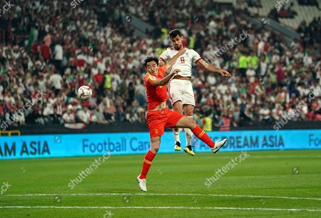 Morteza Pouraliganji of Iran heading on goal during China v Iran at the Mohammed Bin Zayed Stadium in Abu Dhabi, United Arab Emirates, AFC Asian Cup, Asian Football championship
