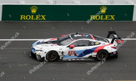 Stock Image of The BMW M8 GTE driven by Alex Zanardi, Jesse Krohn, John Edwards and Chaz Mostert is shown during practice for the IMSA 24 hour race at Daytona International Speedway, in Daytona Beach, Fla