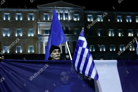 Protesters holds flags during a demonstration against the Prespes Agreement between Athens and Skopje regarding the name 'Northern Macedonia' for the Balkan country, outside the Greek Parliament in Syntagma Square, Athens, Greece, 24 January 2019 evening. The discussion on the Prespes Agreement and processing of the draft law ratifying the name issue agreement signed by Greece and the Former Yugoslav Republic of Macedonia (FYROM) began on 23 January and will continue on 25 January, when voting will take place. According to Parliament President Nikos Voutsis, the number of speakers, including the party leaders, will be approximately 230 in total.