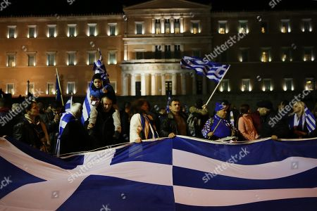 Protesters hold the Greece national flags during a demonstration against the Prespes Agreement between Athens and Skopje regarding the name 'Northern Macedonia' for the Balkan country, outside the Greek Parliament in Syntagma Square, Athens, Greece, 24 January 2019 The discussion on the Prespes Agreement and processing of the draft law ratifying the name issue agreement signed by Greece and the Former Yugoslav Republic of Macedonia (FYROM) began on 23 January and will continue on 25 January, when voting will take place. According to Parliament President Nikos Voutsis, the number of speakers, including the party leaders, will be approximately 230 in total.