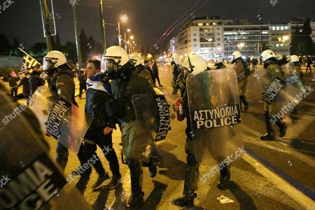 Greek policemen arrest a protester during a demonstration against the Prespes Agreement between Athens and Skopje regarding the name 'Northern Macedonia' for the Balkan country, outside the Greek Parliament in Syntagma Square, Athens, Greece, 24 January 2019. The discussion on the Prespes Agreement and processing of the draft law ratifying the name issue agreement signed by Greece and the Former Yugoslav Republic of Macedonia (FYROM) began on 23 January and will continue on 25 January, when voting will take place. According to Parliament President Nikos Voutsis, the number of speakers, including the party leaders, will be approximately 230 in total.