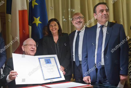 Stock Picture of France Protests. From left to right, Israeli President Reuven Rivlin, Paris' mayor Anne Hidalgo, CRIF President (Representative Council of Jewish Institutions in France) Francis Kalifat, and President of the Central Jewish Consistory of Paris Joel Mergui pose for photographers after they singed the golden book at the city hall in Paris, . Israeli President Reuven Rivlin is for a two-days visit in Paris