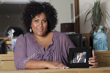 Nicole Lawrence with a Picture of Her Father Greg Lawrence