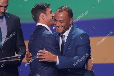 Argentina's former soccer Player Javier Zanetti, left, greets Brazil's Cafu during the draw for the 2019 Copa America soccer tournament in Rio de Janeiro, Brazil, . Brazil will host the continental soccer tournament in June and July